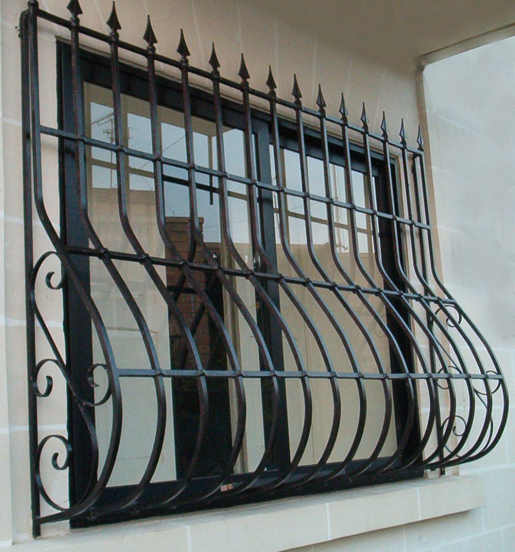thick-black-painted-metal-window-bar-with-sharp-top-design